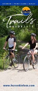 Cover of trails brochure, two people biking
