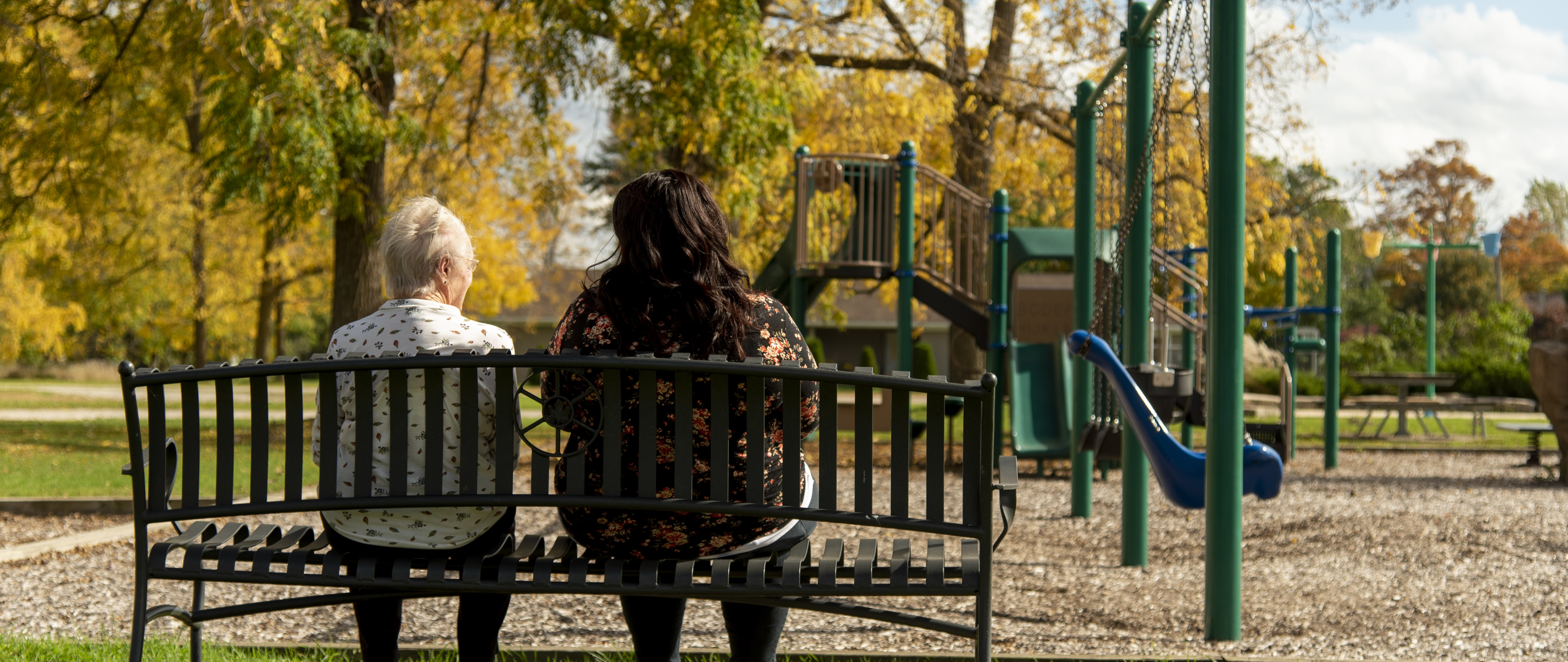 senior and woman at a park
